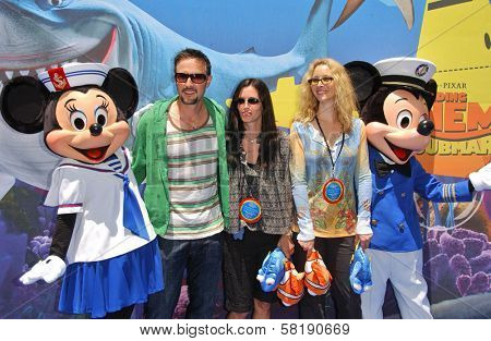 David Arquette with Courtney Cox and Lisa Kudrow at the Opening of Disneyland's