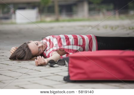 Unconscious Woman On Asphalt Road