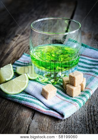 Glass Of Absinth With Lime And Sugar Cubes
