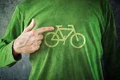 Ride Your Bike. Man Pointing To Bicycle Insignia Printed On His Green Shirt
