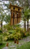 foto of windchime  - A Bamboo wind chime in zen garden