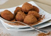 stock photo of truffle  - Chocolate Truffles on a white plate  - JPG