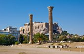 stock photo of olympian  - Two huge columns are the part of ruined Temple of Olympian Zeus with the Acropolis citadel on the background Athens Greece - JPG