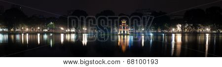 Turtle tower or Tortoise tower in Hoan Kiem lake, Hanoi, Vietnam. Night panoramic view