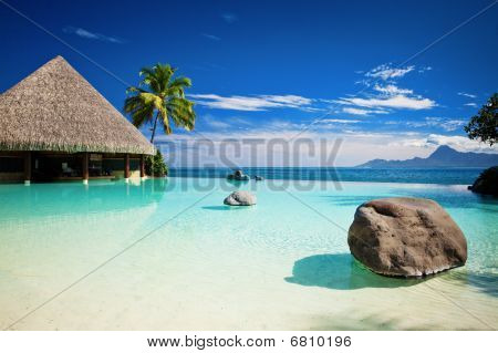Infinity Pool With Artificial Beach And Ocean