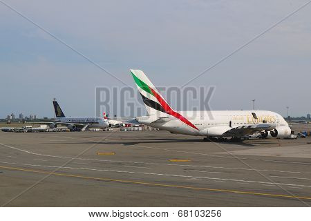 Emirates Airline and Singapore Airlines Airbus A380 jets at JFK Airport  in NY