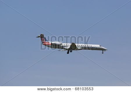 American Eagle Embraer ERJ-145 in New York sky before landing at JFK Airport
