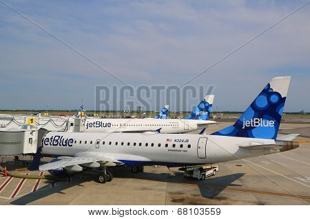 JetBlue Airbus A320 and  Embraer 190 aircraft at the gates at the Terminal 5 at JFK Airport