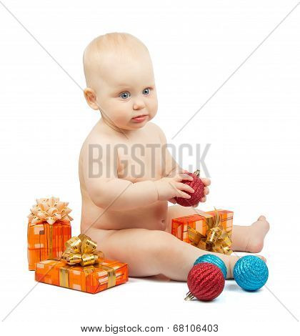 Cute baby holds red ball, christmas gift box