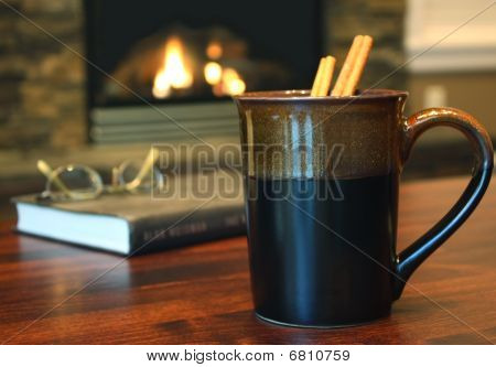 Hot cinnamon tea in dark mug, landscape view