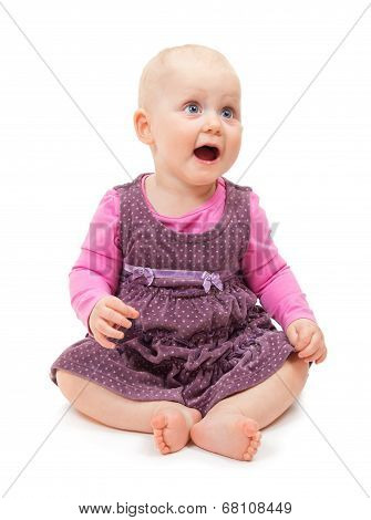 Sweet little girl in violet dress sits