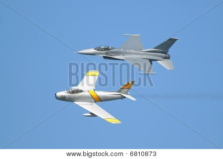 F-16 and F-86 airplanes flying  in formation