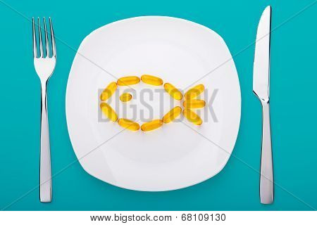 Fish Oil Soft Gels Lying On A Plate