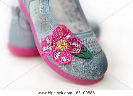 Decorative Element In The Form Of A Flower With Sequins On Children's Shoes.