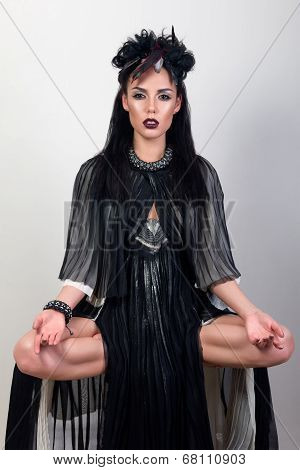 Woman Shaman Levitating Over Grey Background