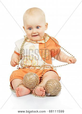 Baby with christmas garland and gold balls