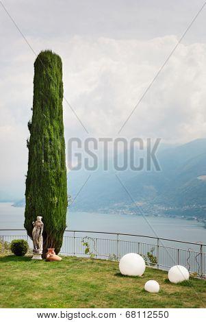 garden, cypress tree, lake view