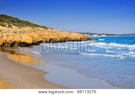 a view of Cala Romana beach in Tarragona, Spain