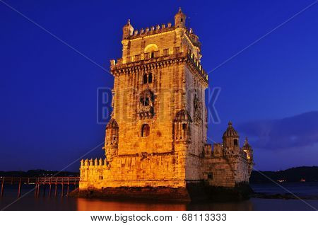 the Belem Tower at night in Lisbon, Portugal