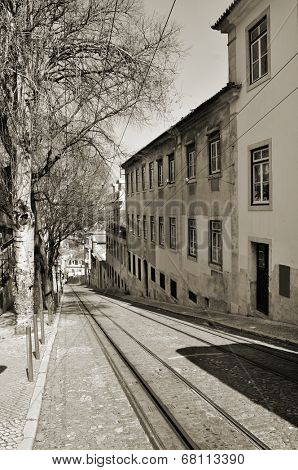view of Calcada da Gloria, with the rails of the Gloria Funicular, in Lisbon, Portugal