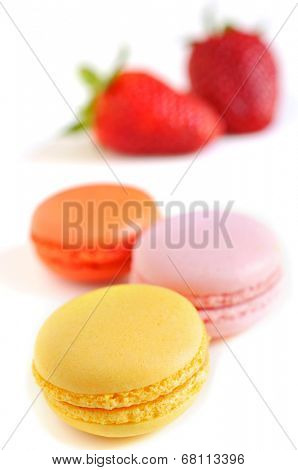 some appetizing macarons with different colors and flavors on a white background
