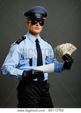 Policeman shows money and document