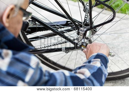 Tightening The Bolts On A Bicycle Wheel