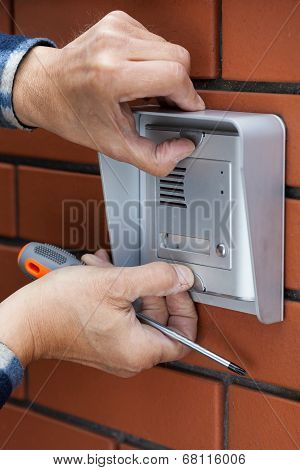 Male Hands Repairing Intercom