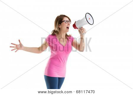 Young woman shouting into bullhorn over white background