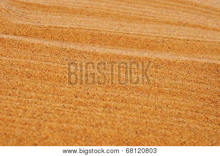 closeup of raked sand of a beach, of a sandpit or of a zen garden