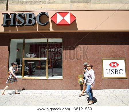 NEW YORK CITY - FRIDAY, JUNE 20, 2014:   Pedestrians walk past a HSBC bank in Manhattan on Friday, June 20, 2014. HSBC Holdings plc is a British multinational banking and financial services company