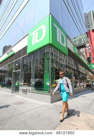 NEW YORK CITY - FRIDAY, JUNE 20, 2014:   Pedestrians walk past TD Bank, N.A. in New York City on Wednesday, July 2, 2014. TD or Toronto Dominion is a major savings bank.