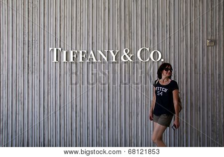 SANTA MONICA, CALIFORNIA - TUES. JUNE 24, 2014: A woman walks past a Tiffany & Co. jewelry store in Santa Monica, California, on Tuesday, June 24, 2014.