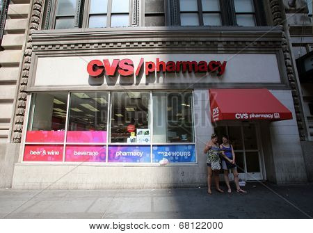 NEW YORK CITY - FRIDAY, JUNE 20, 2014: Shoppers walk past a CVS drug store in New York City on Wednesday, July 2, 2014.  CVS is the retail division of CVS Caremark