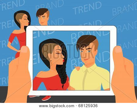 Photographing of happy couple on blue background using white tablet pc