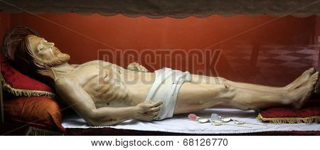 PORTOFERRAIO, ELBA, ITALY - MAY 03, 2014: Statue of Jesus Christ in the tomb in the Church of the Holy Sacrament in Portoferraio, Island of Elba, Tuscany, Italy on May 03, 2014