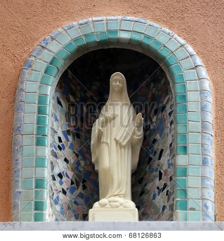 MANAROLA, ITALY - MAY 02: one of the Cinque Terre villages, UNESCO World Heritage Sites, religious chantry with a Madonna statue in one of the streets of the center, on May 02, 2014 in Manarola, Italy
