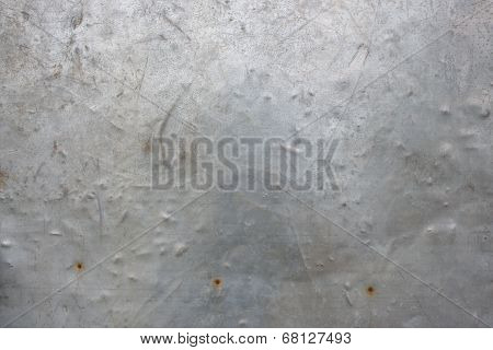 The vintage gray rusty grunge iron metallic textured background metal texture with scratched plate s
