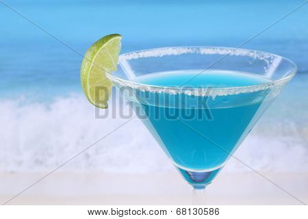 Blue Curacao Cocktail On The Beach With Copyspace
