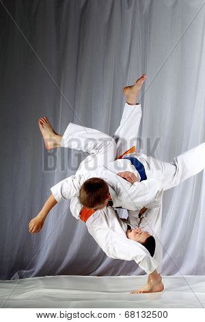 In judogi two athletes doing judo throws