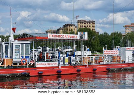 DOLGOPRUDNY, MOSCOW REGION, RUSSIA - JULY 4, 2014: River fuel station in the yacht club of Moscow River Shipping Company. Founded in 1857, now it manages 26 enterprises with more than 5700 employees