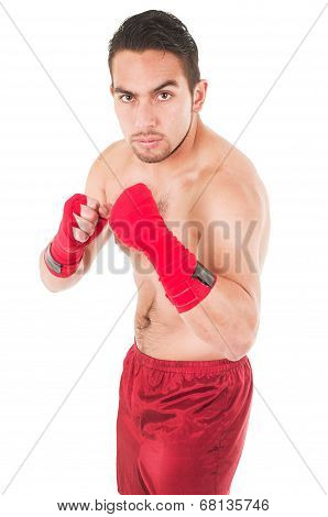 martial arts fighter wearing red shorts and wristband