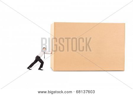Determined businessman pushing a huge box isolated on white background