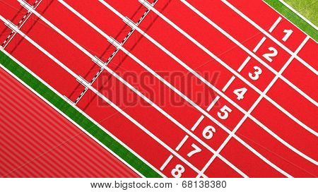 Rows of hurdles on running track top view