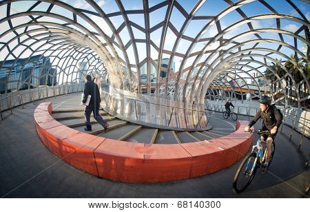 MELBOURNE, AUSTRALIA - July 3 2014:  Webb Bridge is an award winning bridge crossing the Yarra River at Docklands Park