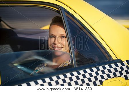 People Travelling-business Woman In Yellow Taxi