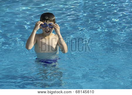 Child In Swiming Pool