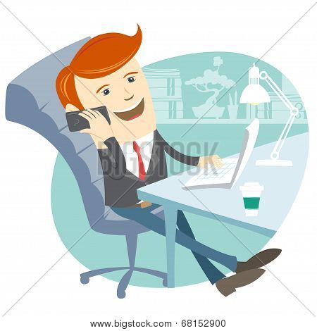 Office man sitting at his working desk with phone