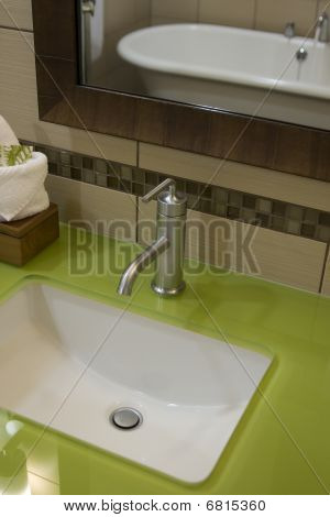 Custom Bathroom With Green Glass Countertops