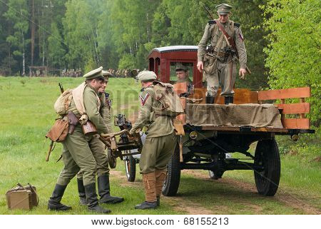 Soldiers Load The Maxim Machine Gun On Truck